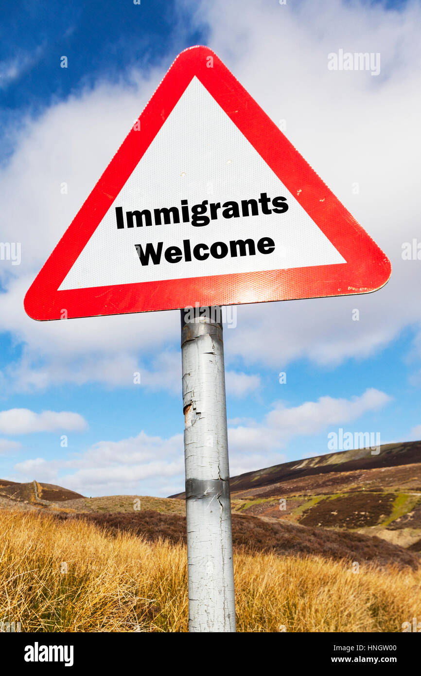 Immigrants welcome sign UK immigration crisis welcoming immigrants to country sign signs concept - Stock Image