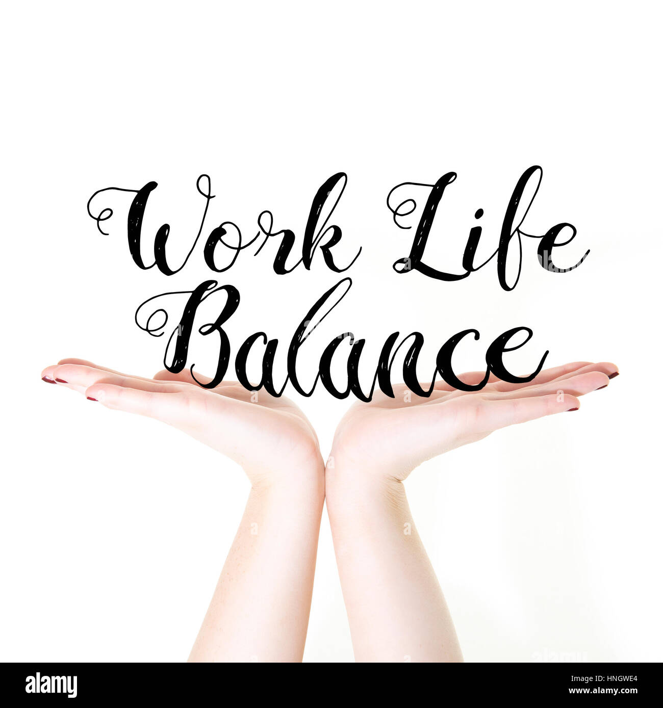 Hands holding the words Work Life Balance on a white background - Stock Image
