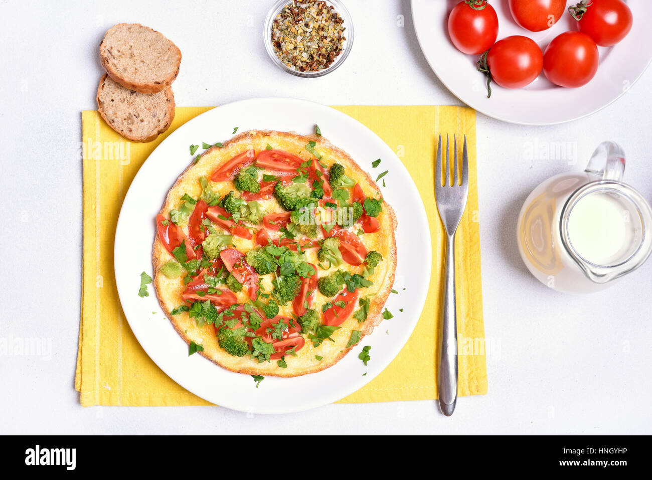 Omelet with vegetables on plate, top view. - Stock Image