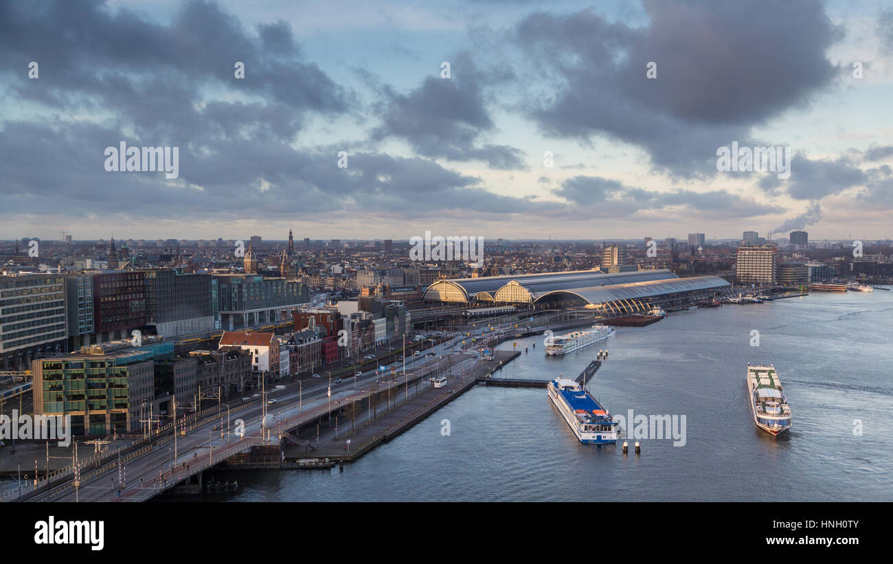 View of Amsterdam with river IJ, Amsterdam Centraal Station, Amsterdam, The Netherlands - Stock Image