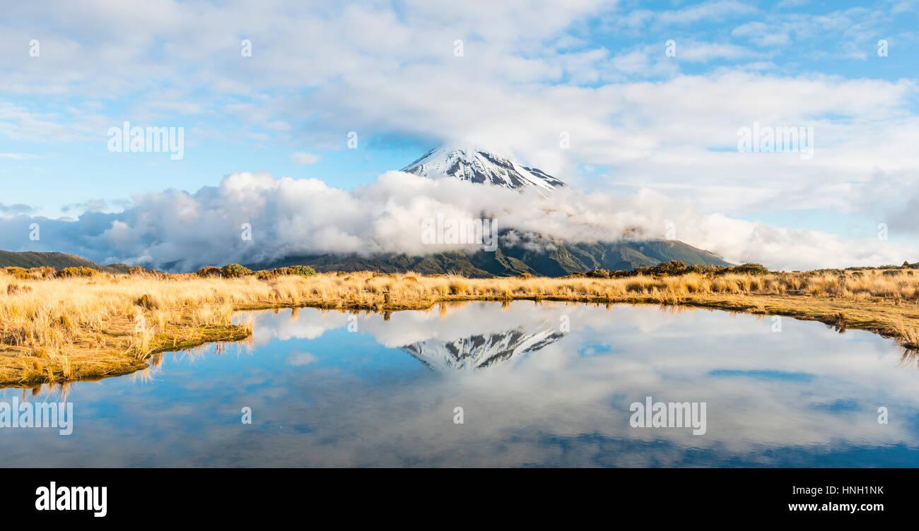 Reflection in Puakai Tarn, stratovolcano Mount Taranaki or Mount Egmont, Egmont National Park, Taranaki, New Zealand - Stock Image