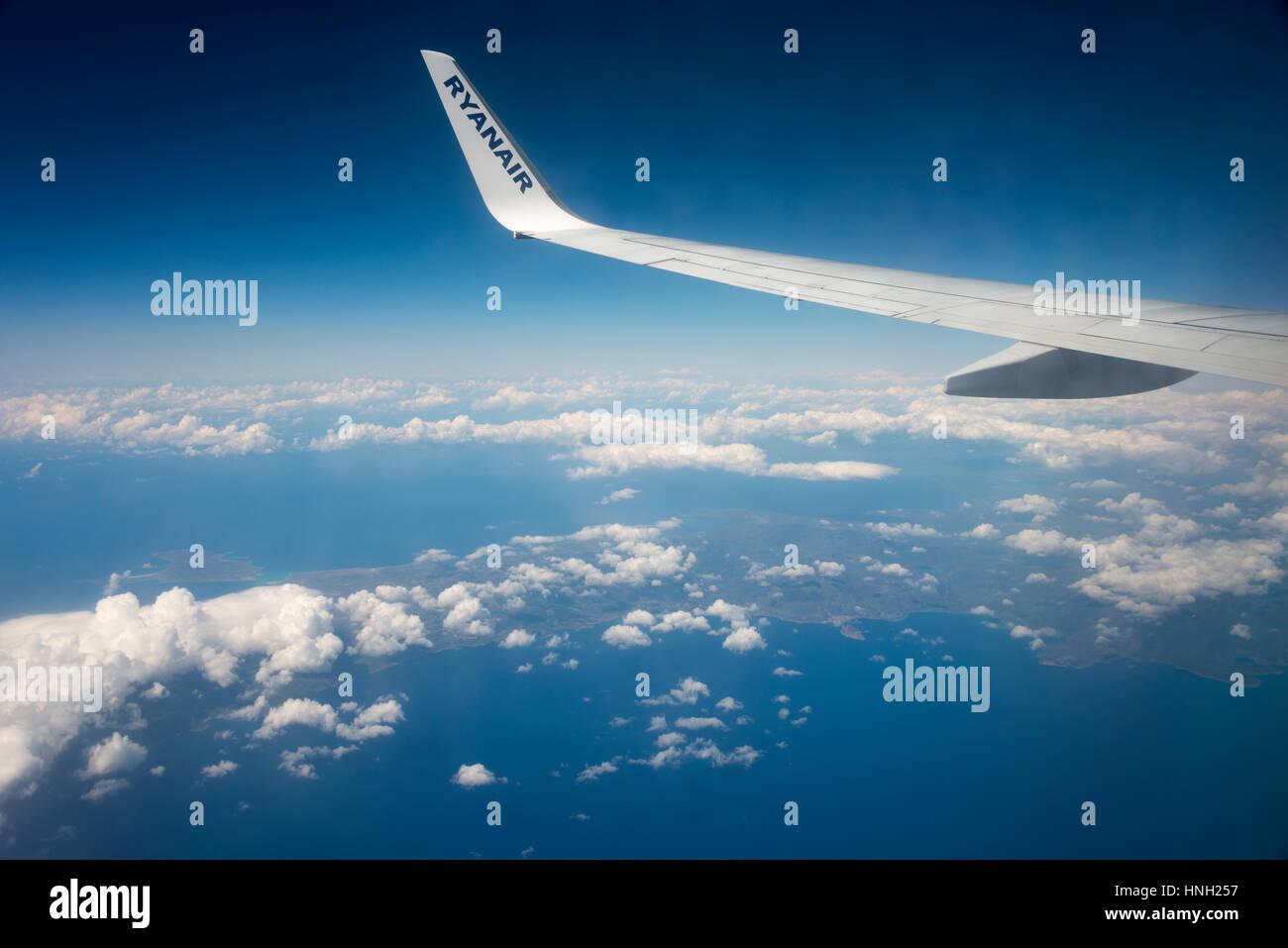 Airplane wing, Ryanair plane over Greece - Stock Image