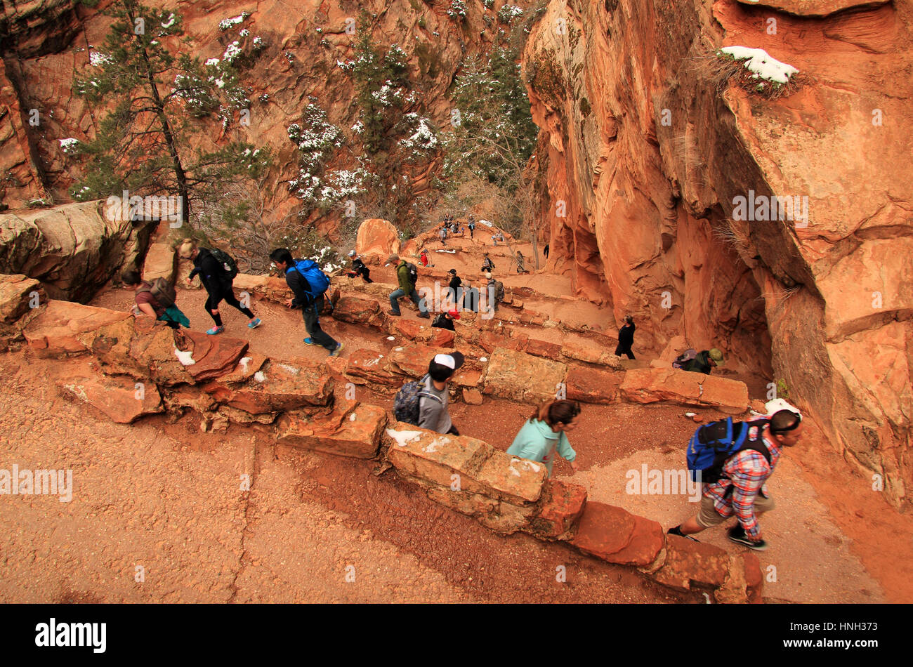 ZION NATIONAL PARK, UT - MARCH 30: Hikers make their way along Walter's Wiggles, a series of sharp switchbacks along Stock Photo