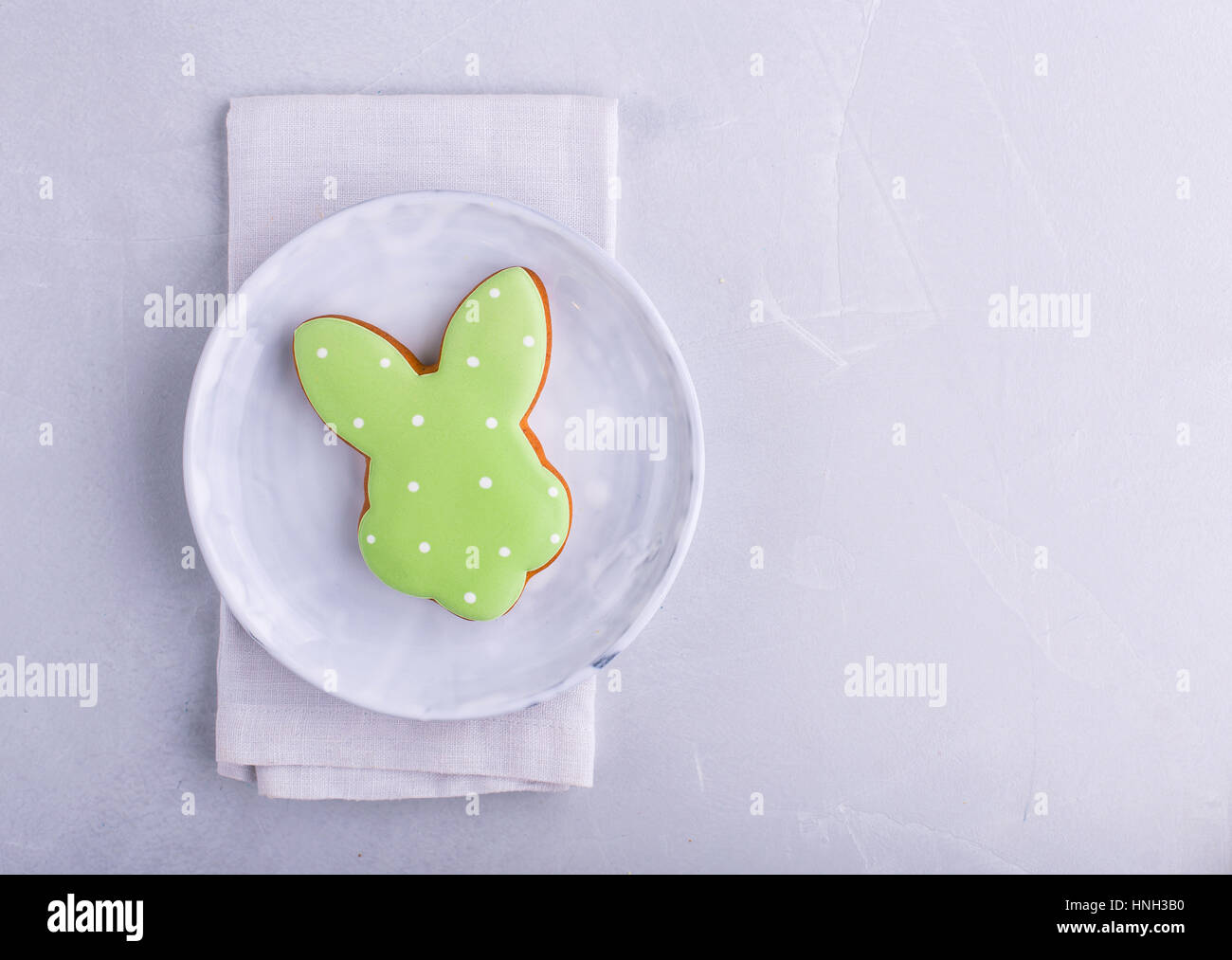 Easter bunny gingerbread shot from above  on grey background with space for text Stock Photo