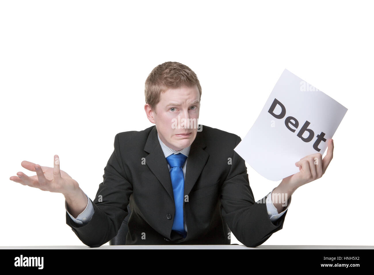 business man holding a paper sign with the words money worries writen on it looking unhappy - Stock Image
