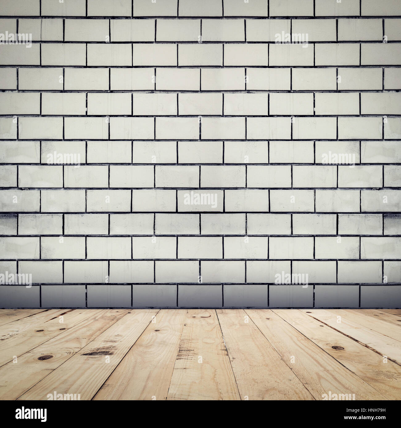 Grunge white brick wall background and wood floor perspective room interior