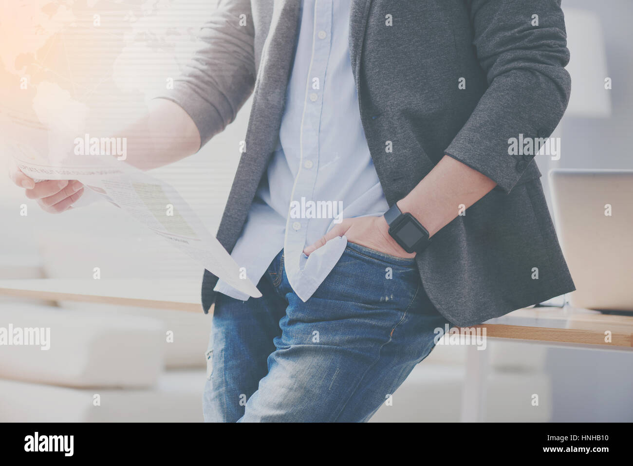 Pleasant man holdign his hand in a pocket - Stock Image