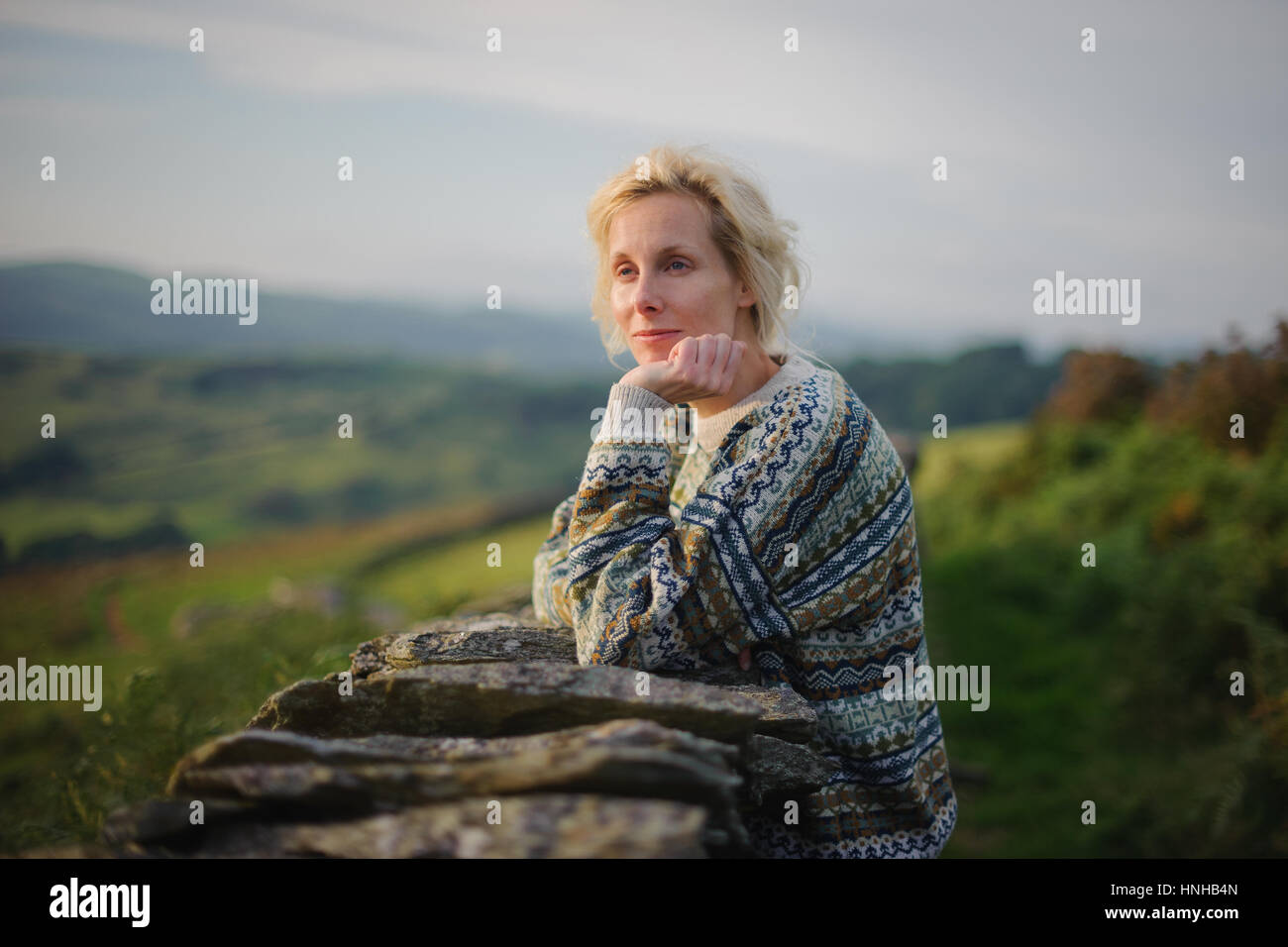 Woman in the countryside - Stock Image