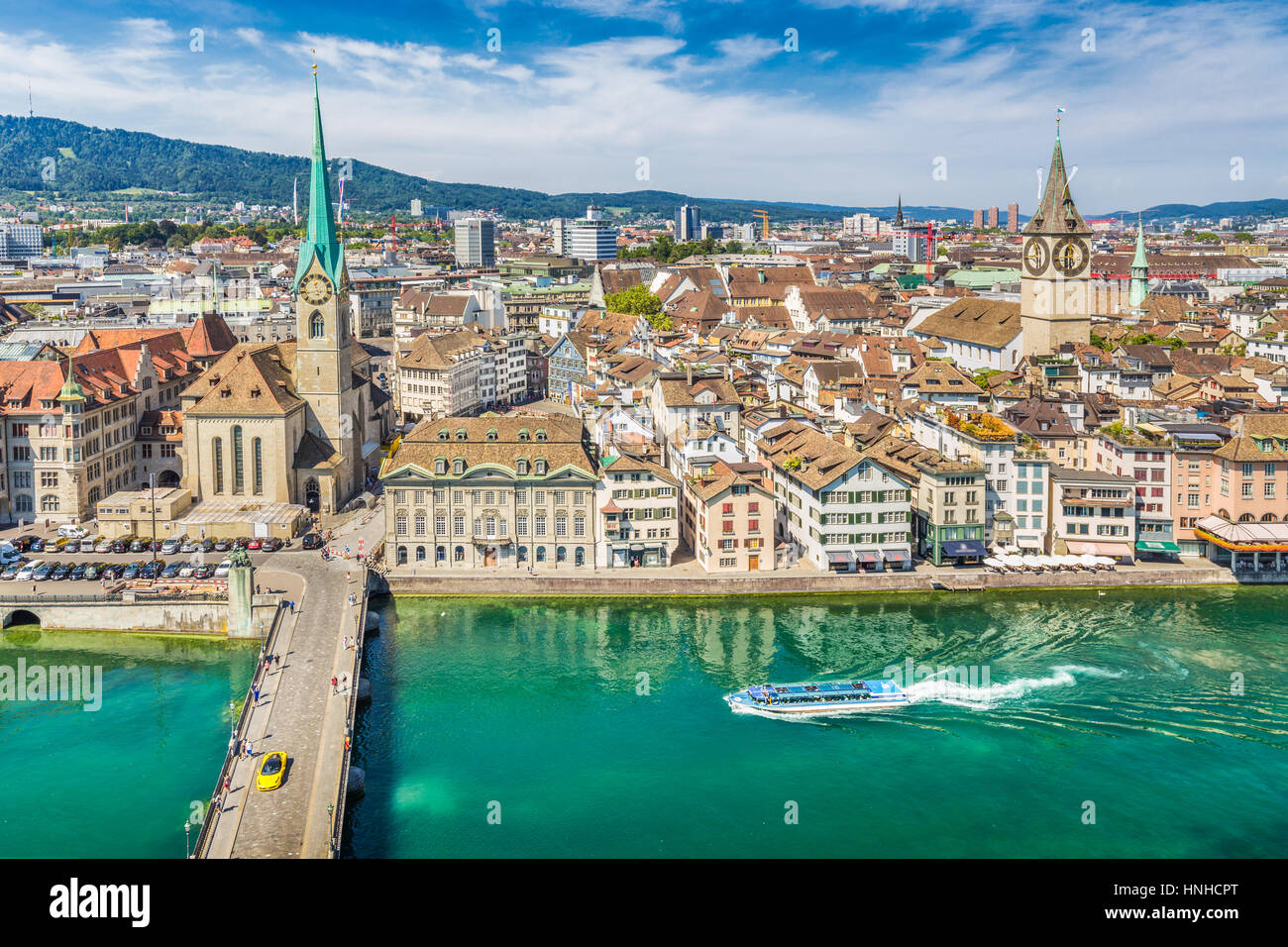 Aerial view of Zürich city center with famous Fraumünster and Sankt Peter Churches and river Limmat at - Stock Image