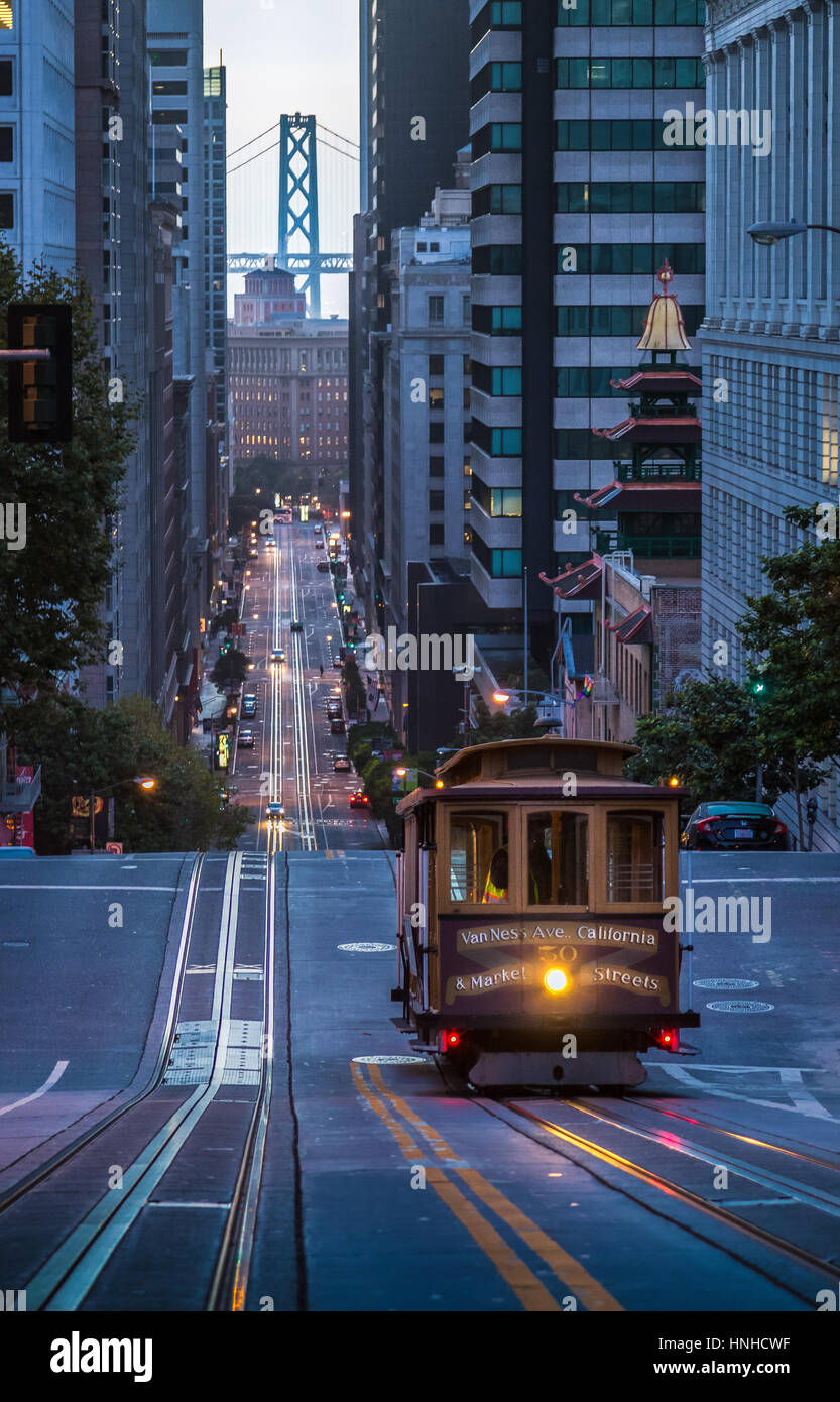 Classic view of historic Cable Car riding on famous California Street in beautiful early morning twilight before - Stock Image