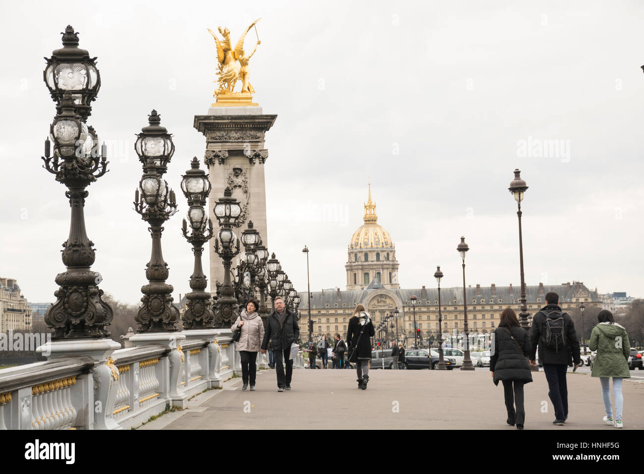 pont alexandre iii with chapel of saint louis des invalides in the