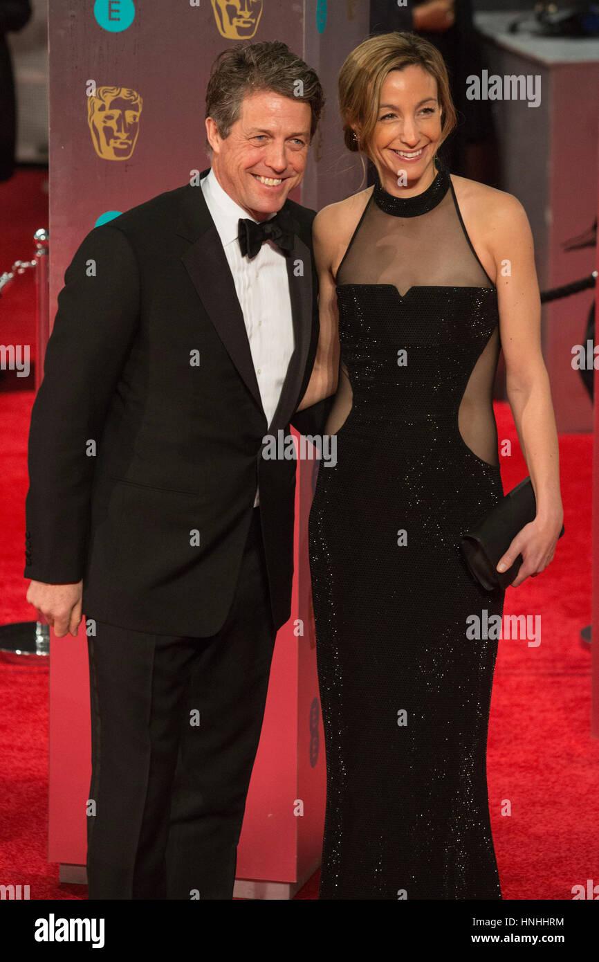 London, UK. 12th Feb, 2017. Hugh Grant, Anna Elisabet Eberstein. Red carpet arrivals for the EE British Academy - Stock Image