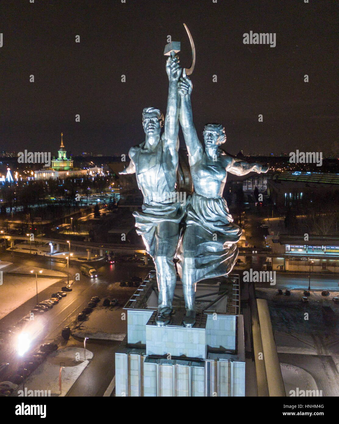 Moscow, Russia. 13th Feb, 2017. The statue of Worker and Kolkhoz Woman by Vera Mukhina lit at night, at the entrance - Stock Image