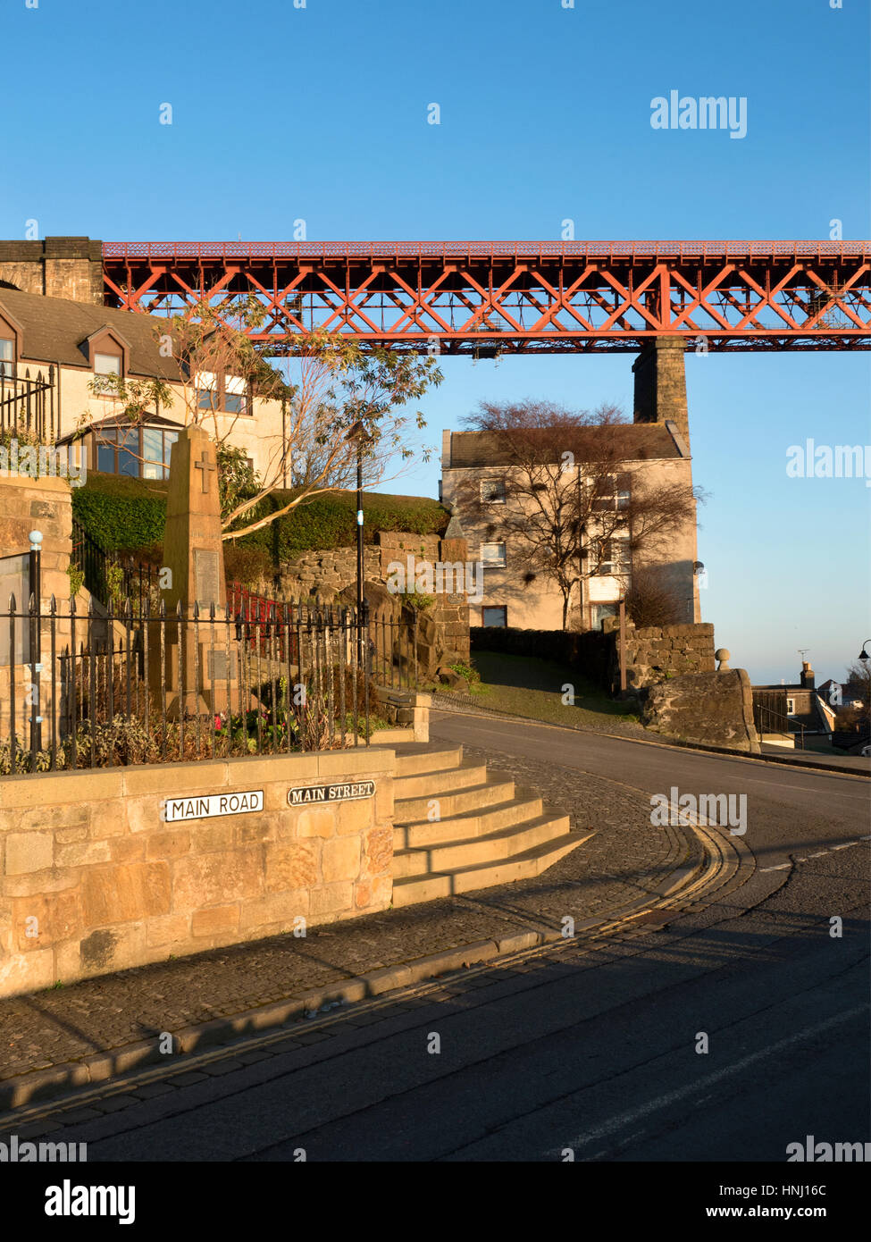 The Forth Bridge Looms over the Main Street at North Queensferry Fife Scotland - Stock Image