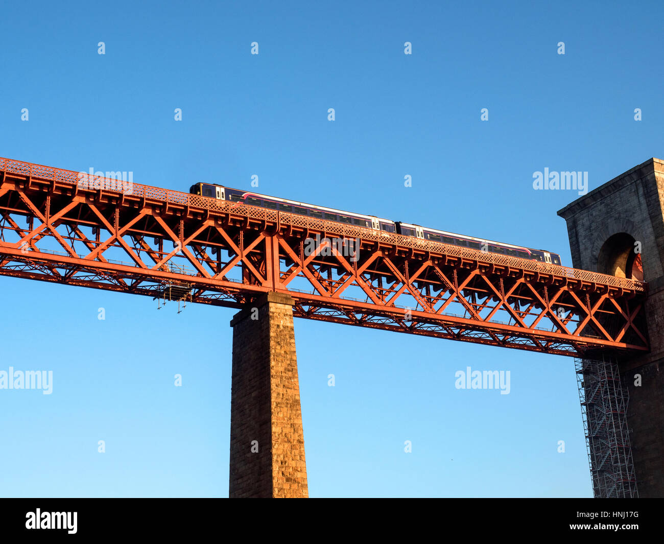 Passenger Train Crossing the Forth Bridge at North Queensferry Fife Scotland - Stock Image