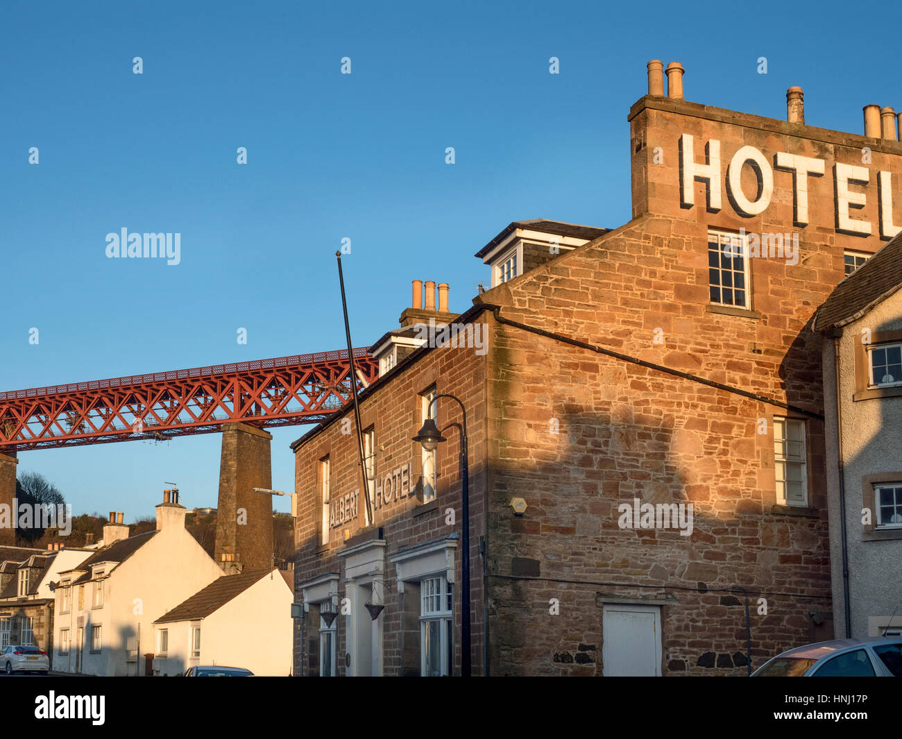 Forth Bridge and Albert Hotel at North Queensferry Fife Scotland - Stock Image