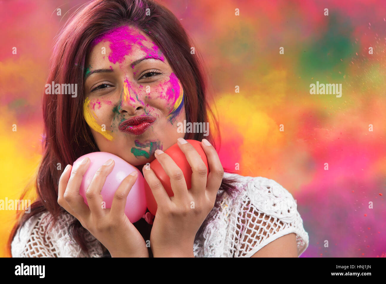 Indian Happy Young Girl With Holi Balloons at Holi Festival Stock Photo
