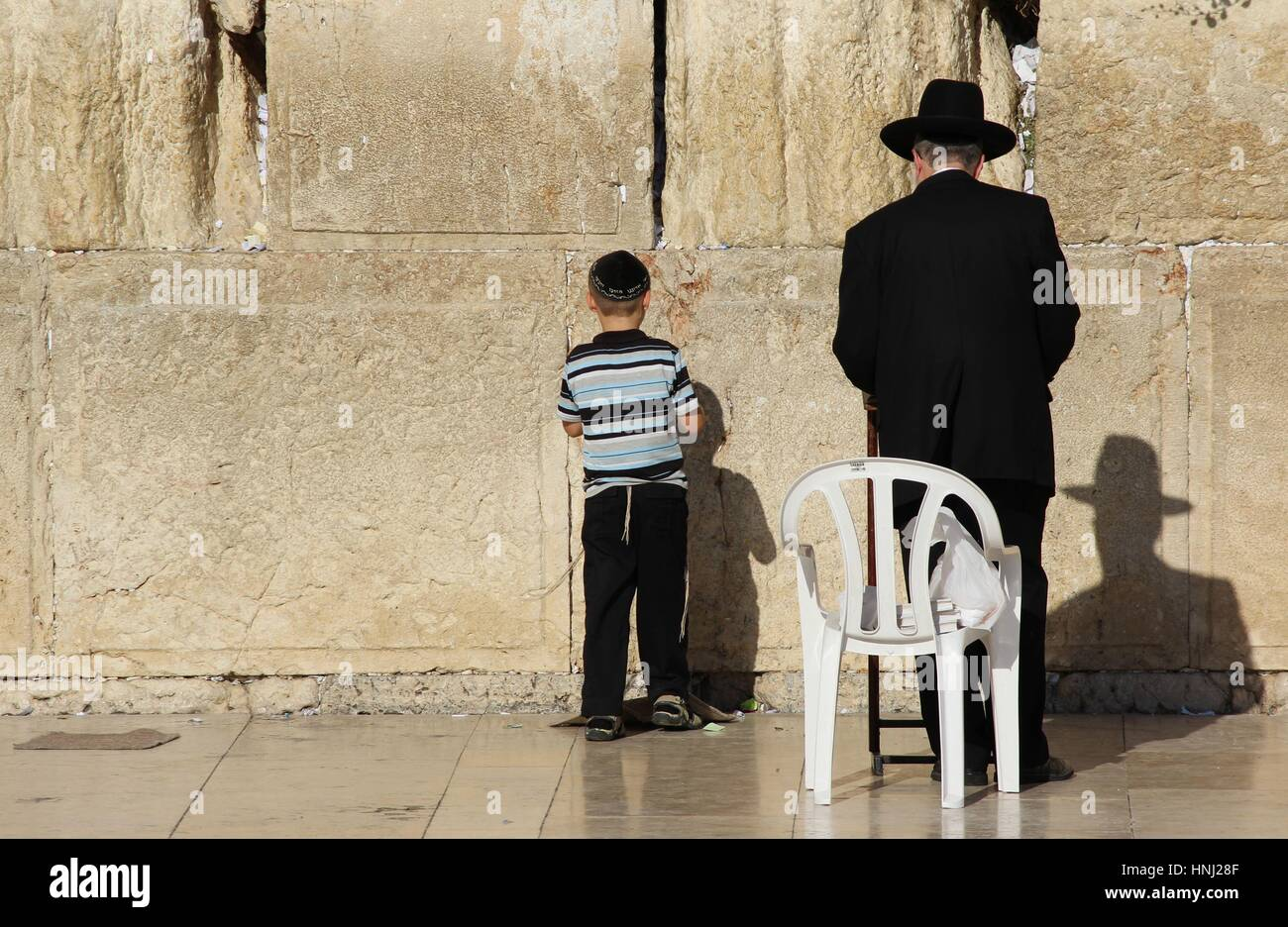 Man and Child Praying at the Wailing Wall - Stock Image