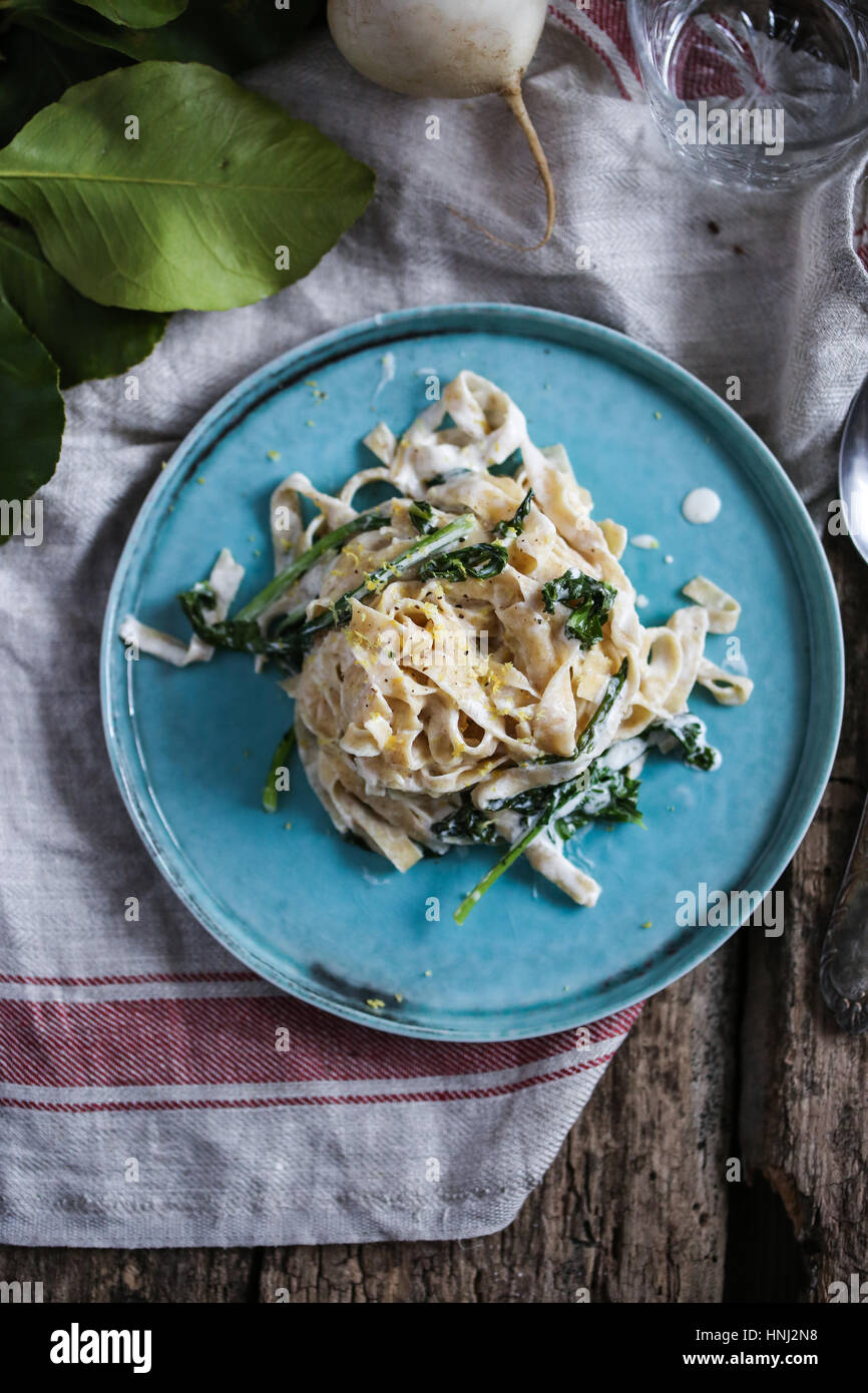 Homemade chickpea tagliatelle with white beet greens, anchovies and lemon zest - Stock Image