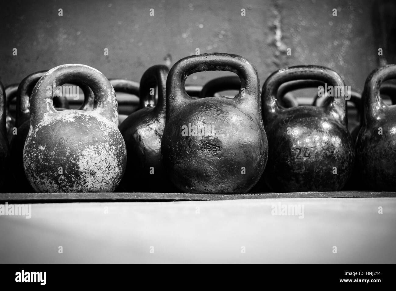 39b7988e886 Old worn dumbells in gym in black and white Stock Photo  133777816 ...