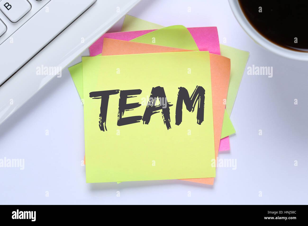 Team teamwork working together office desk computer keyboard - Stock Image