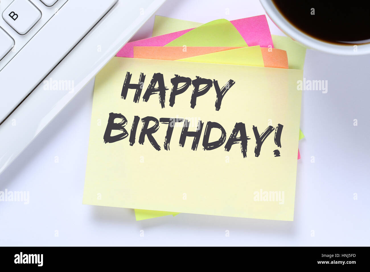 Happy Birthday greetings celebration business desk computer keyboard - Stock Image