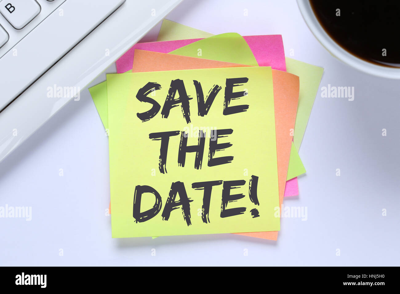 Save the date invitation message business information desk computer keyboard - Stock Image