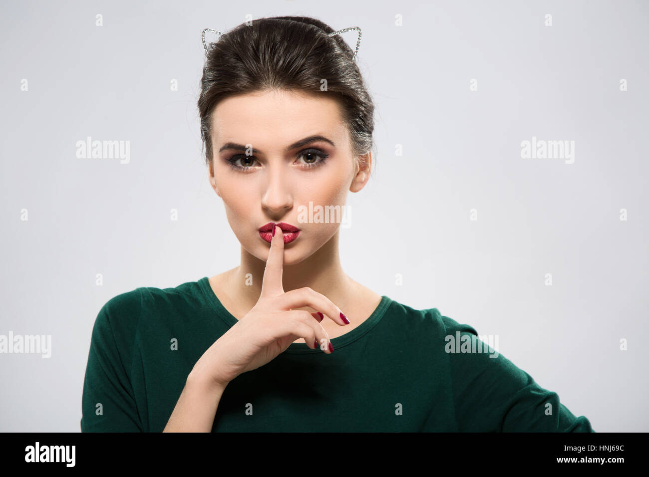A portrait of lovely woman with dark hair - Stock Image