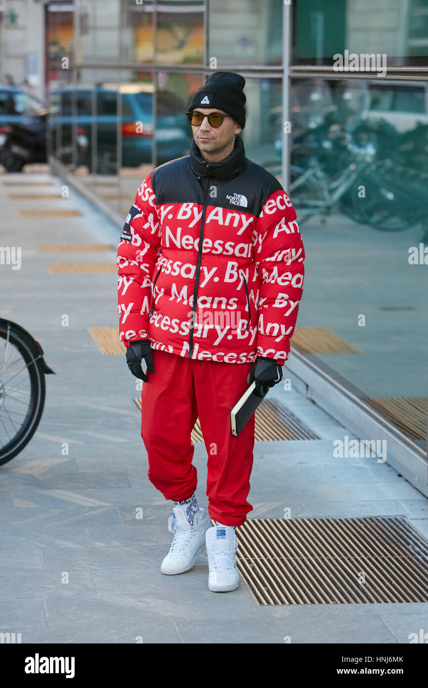 Man with The North Face red jacket and trousers before Emporio Armani  fashion show 4f993b1de