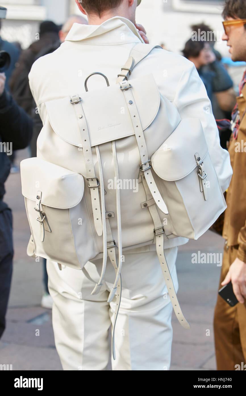 Man with white Salvatore Ferragamo leather backpack before Salvatore Ferragamo fashion show, Milan Fashion Week - Stock Image