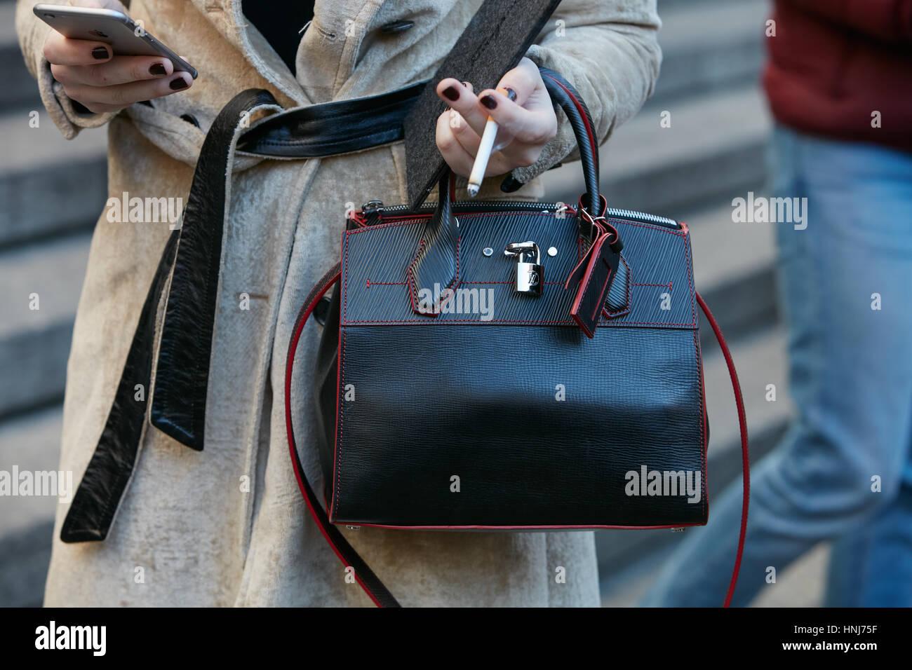 3b8373096 Woman with black and red Louis Vuitton bag before Salvatore Ferragamo fashion  show, Milan Fashion
