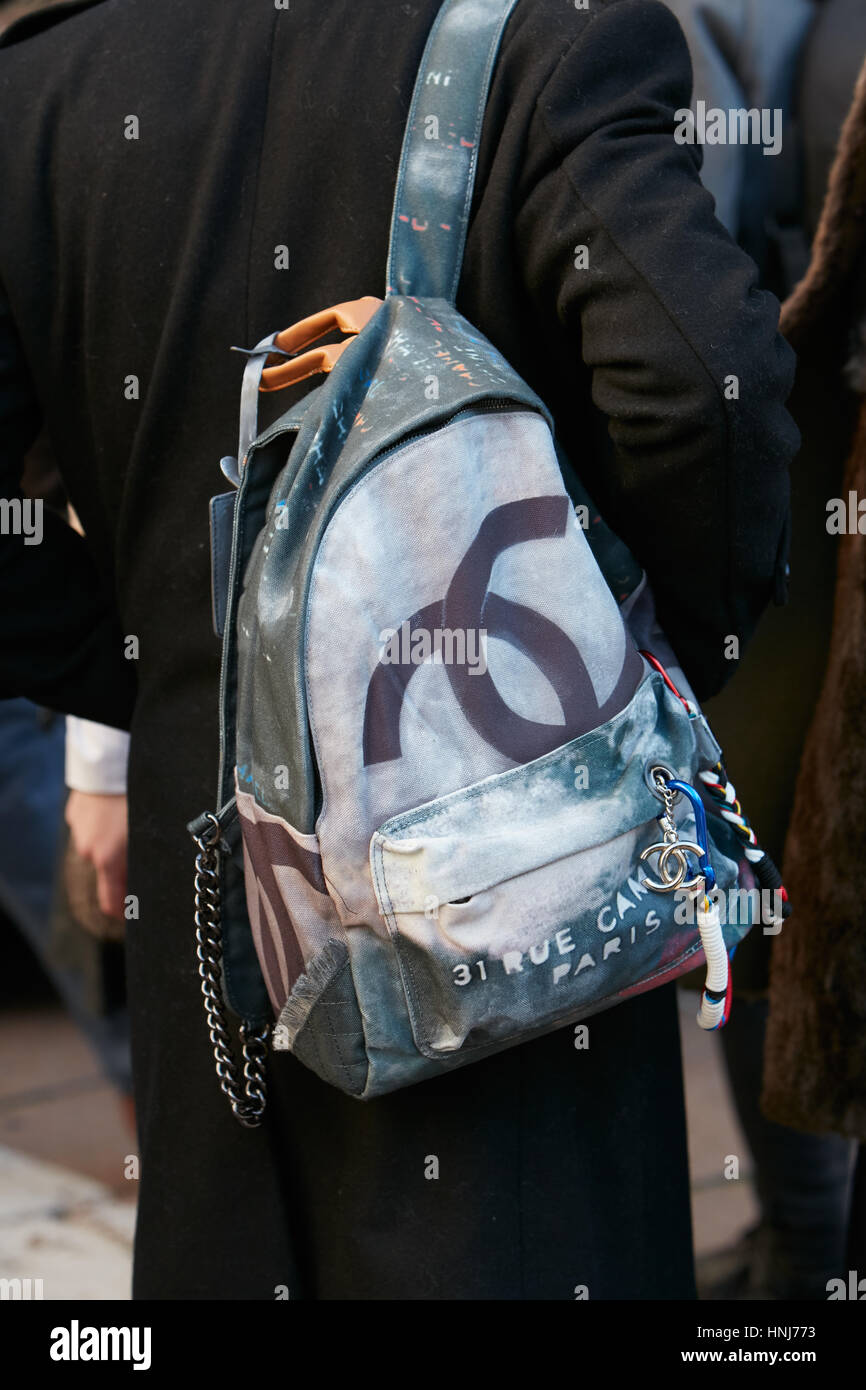 Man with Chanel backpack before Salvatore Ferragamo fashion show, Milan Fashion Week street style on January 15, - Stock Image