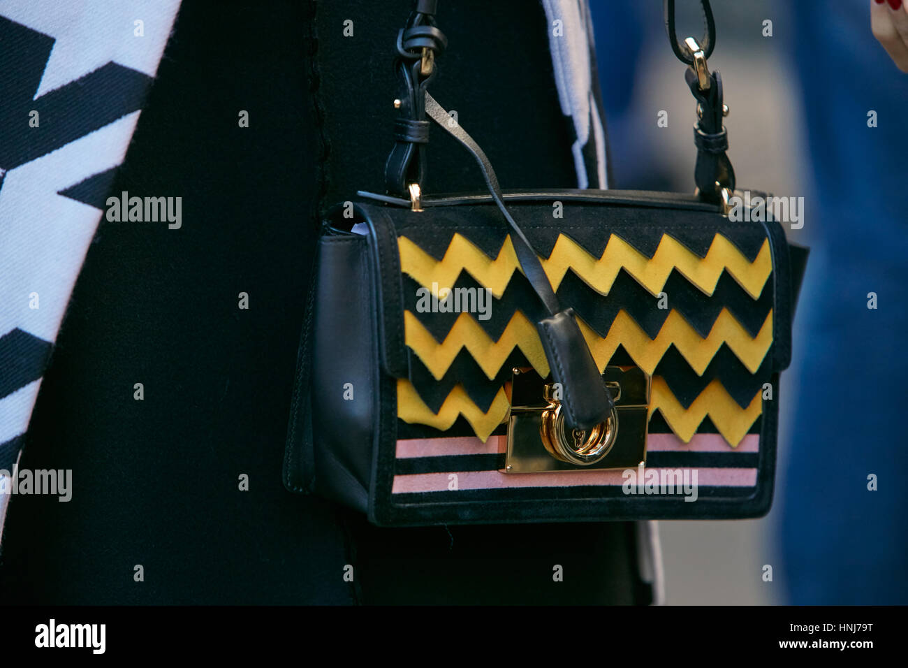 41a7888471 Woman with yellow and black bag before Salvatore Ferragamo fashion show