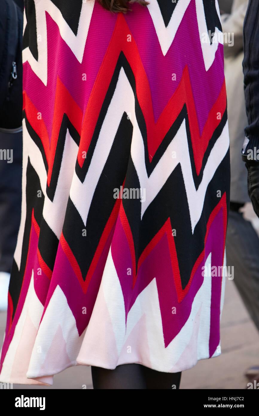 Woman with Ferragamo cloak in red, purple and white colors before Salvatore Ferragamo fashion show, Milan Fashion - Stock Image