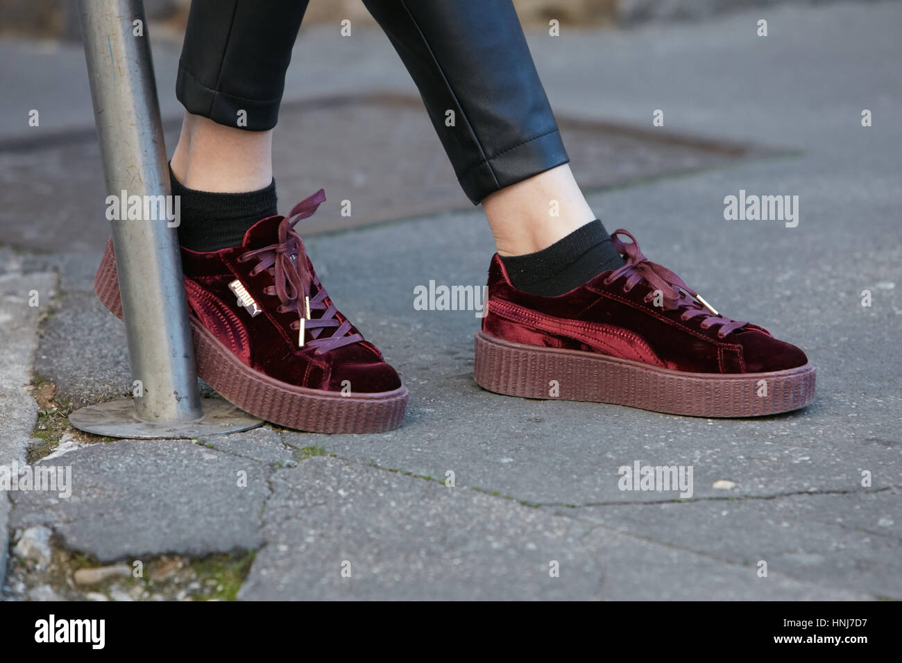 hot sale online c8096 17e61 Woman with red velvet Puma shoes before Salvatore Ferragamo fashion show,  Milan Fashion Week street