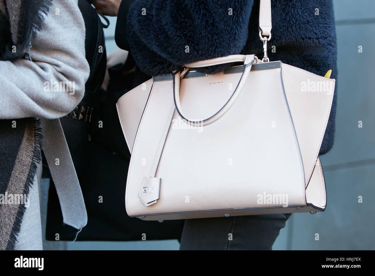 Woman with pink Fendi leather bag before N 21 fashion show 289fe8a2ccda9