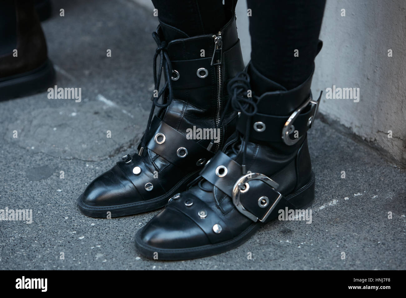 Woman with black leather shoes with belts before N 21 fashion show, Milan Fashion Week street style on January 16, - Stock Image