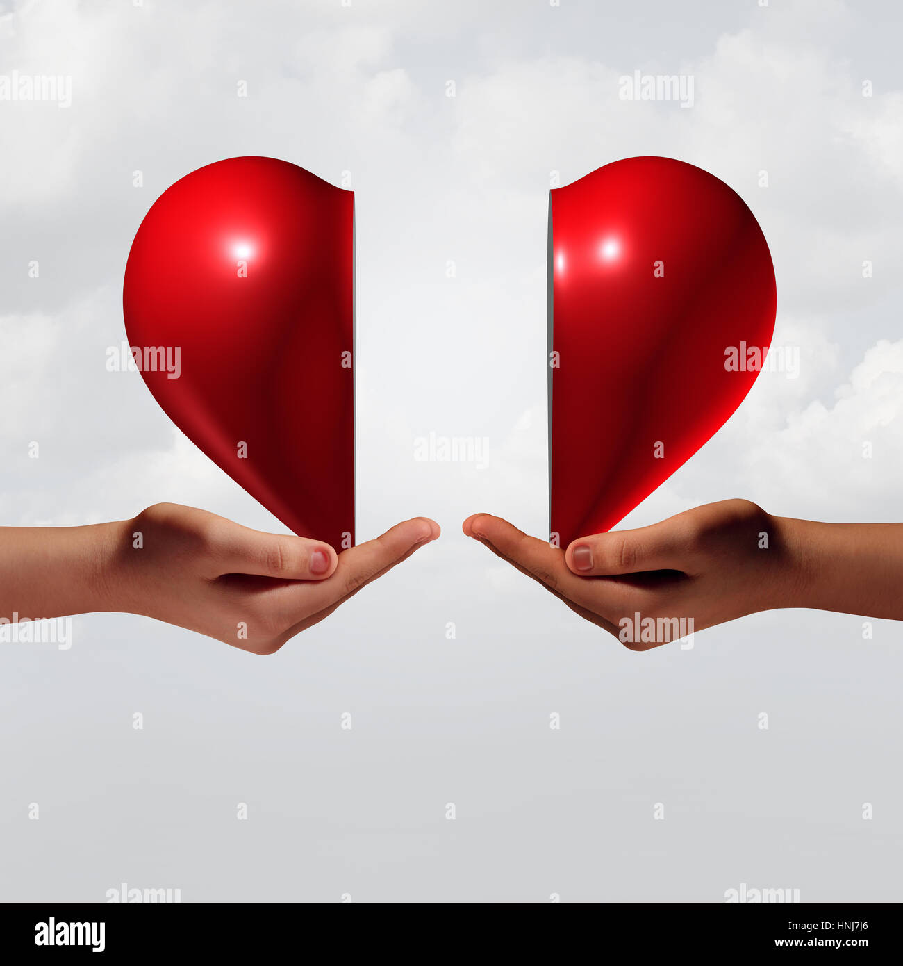 Love connection romance and relationship couple trouble concept as two human hands holding a valentine day heart. - Stock Image