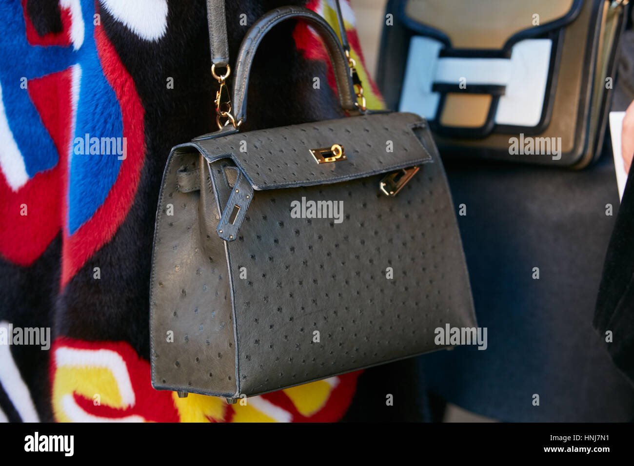 Woman with gray ostrich leather bag before Etro fashion show, Milan Fashion Week street style on January 16, 2017 - Stock Image