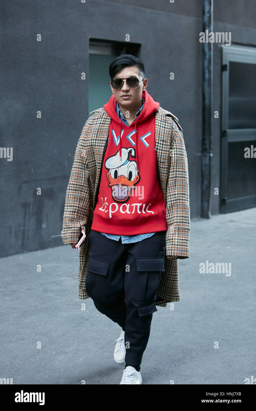 11ce6fb4941 Man with red Gucci Donald Duck sweater before MSGM fashion show ...