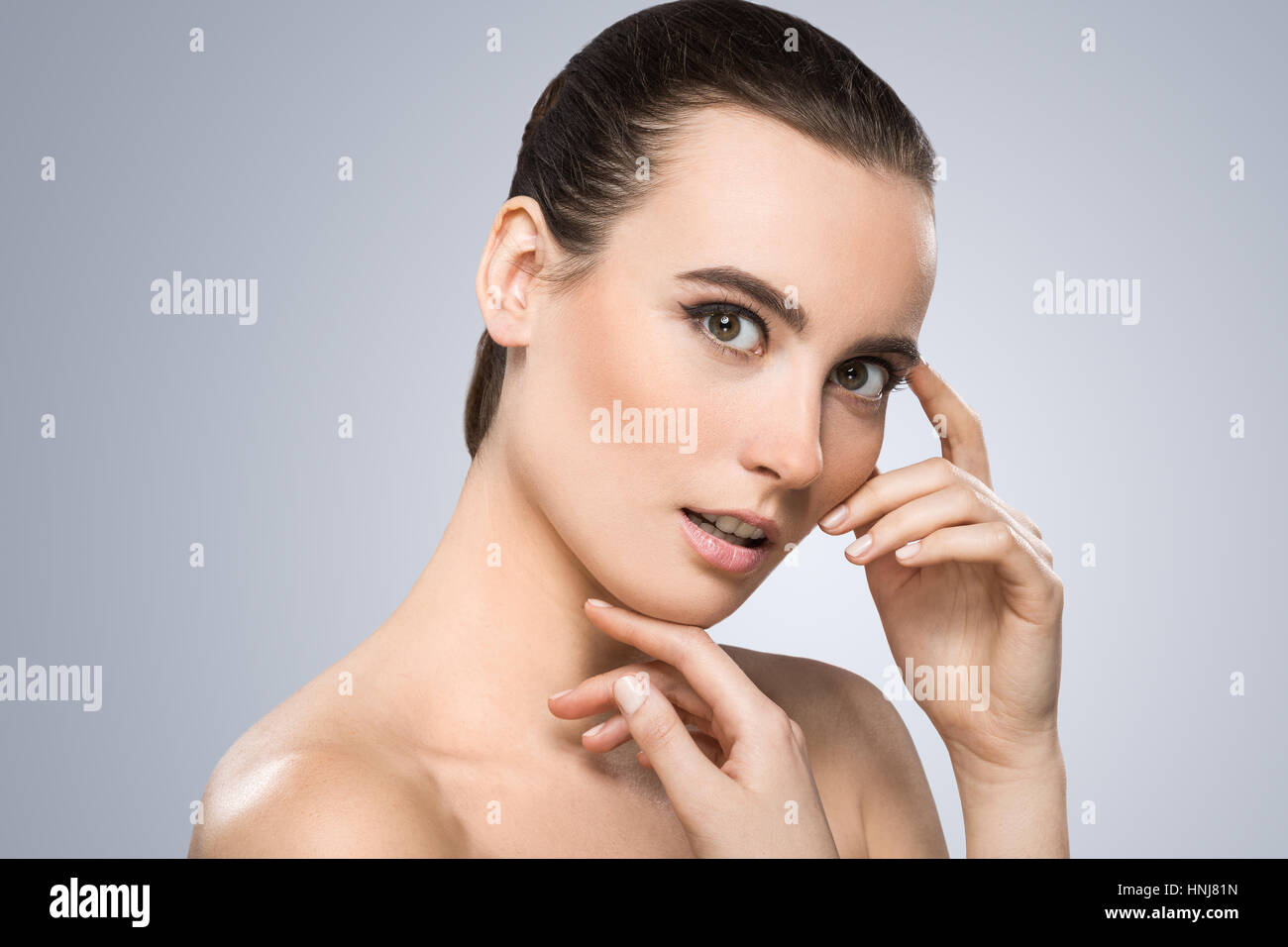 Model smiling surprisingly - Stock Image