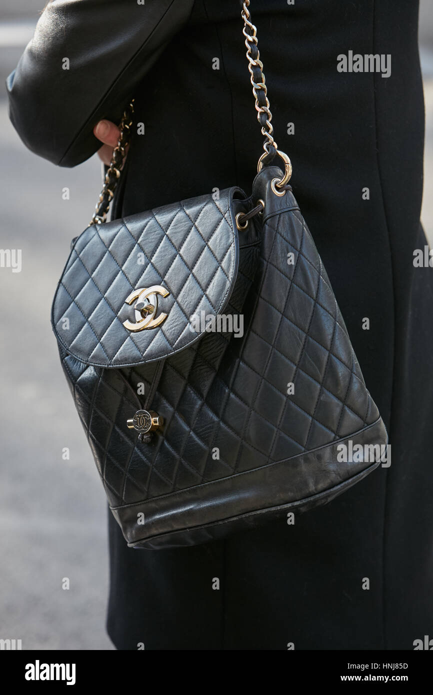 6fa40c4db622 Woman with black Chanel leather bag before Giorgio Armani fashion show