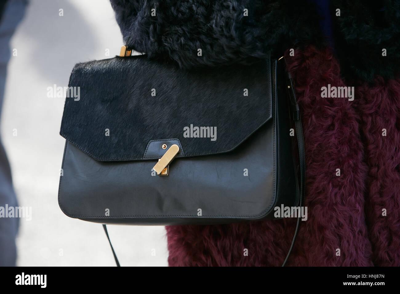 71f6cd539b Woman with black leather and fur bag before Giorgio Armani fashion show