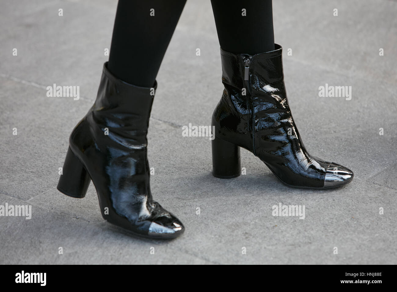 Woman with patent leather black shiny