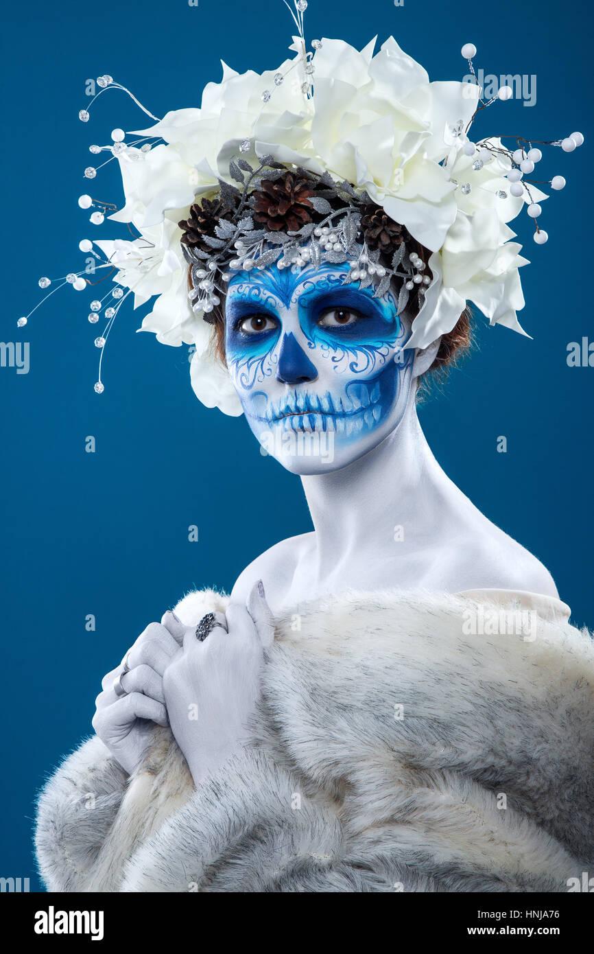 Santa Muerte woman at blue background - Stock Image
