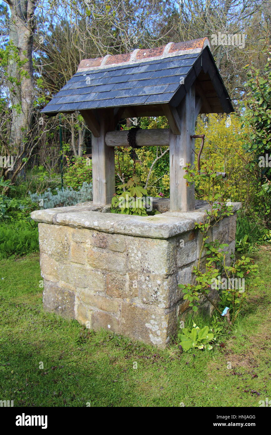 Well in a garden - Stock Image