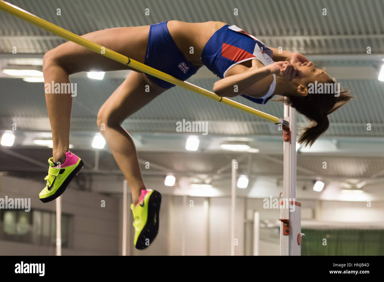 Morgan Lake clears the high jump bar during the British Athletics Indoor Team Trials at the English Institute of - Stock Image