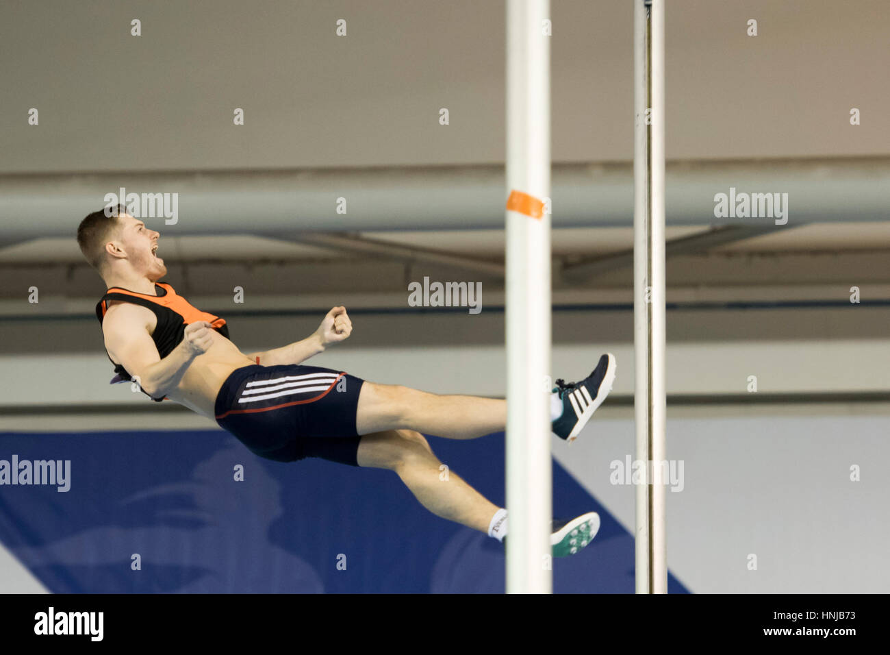A pole vaulter celebrates as he clears the bar at the British Athletics Indoor Team Trials at the English Institute - Stock Image