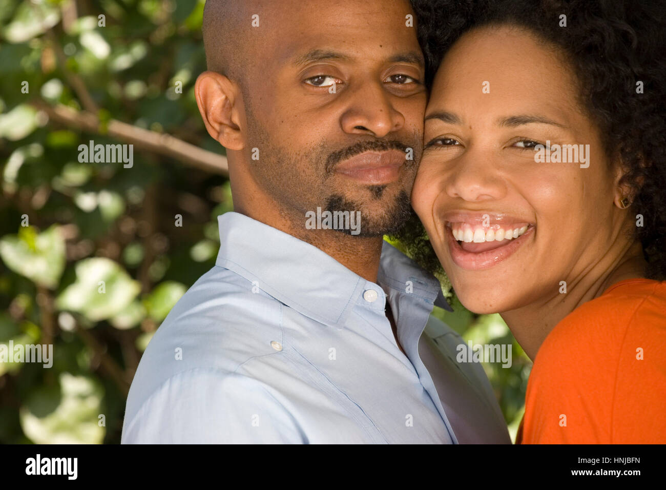 Romantic African American couple hugging outside. - Stock Image