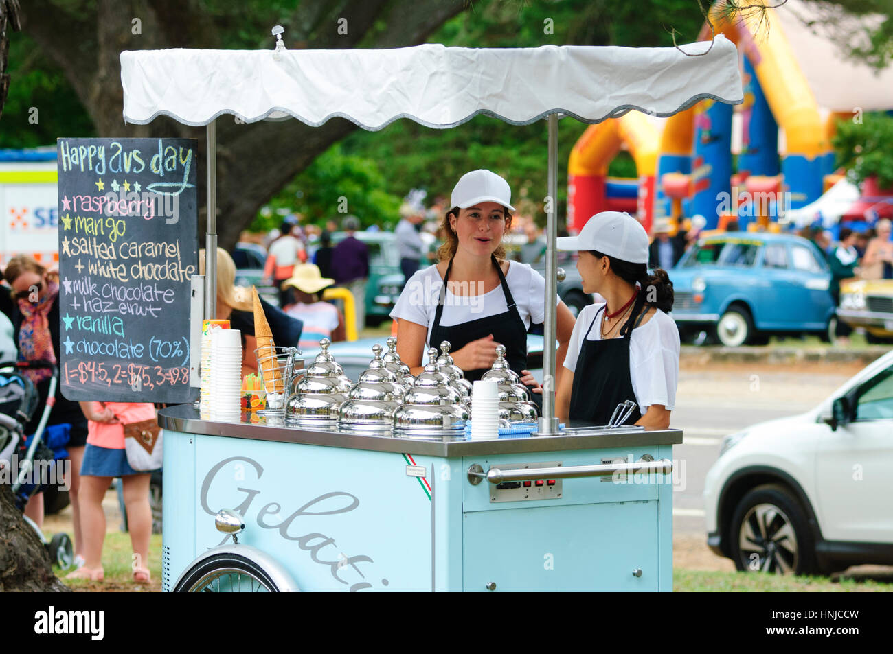 Two attractive young women selling ice creams, Berrima, New South Wales, Australia - Stock Image